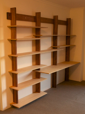 Custom made cantilevered bookshelves, Australian blackwood frame, plywood shelves, finished with Danish oil and bees wax