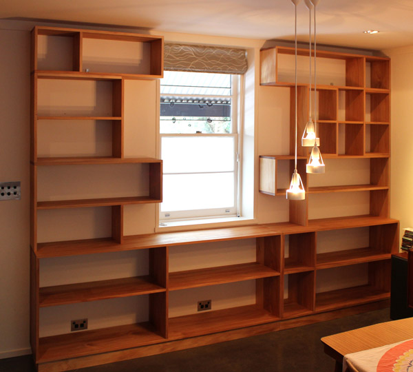 Custom made bookshelves around window