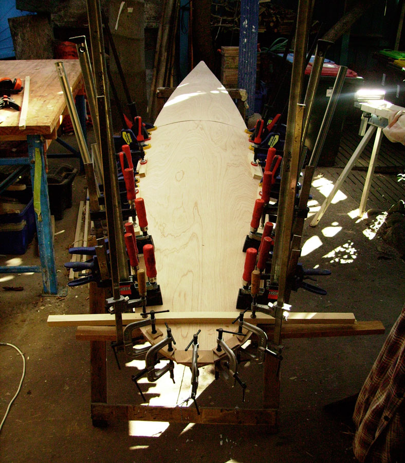 paddleboard in progress, clamps in place